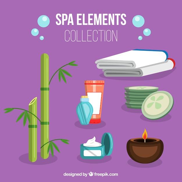 Ensemble d'éléments de centre de spa avec des bougies et des huiles aromatiques Vecteur gratuit