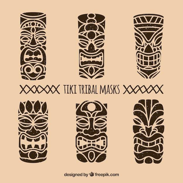 Ensemble de masques tribaux dessinés à la main Vecteur gratuit