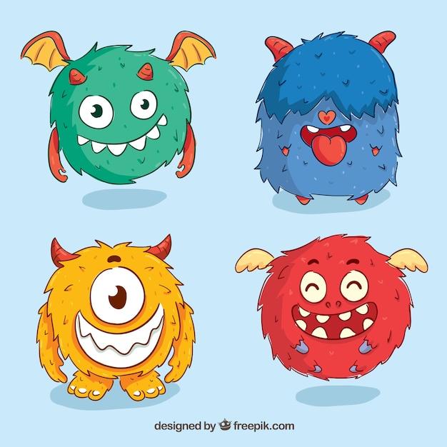 Ensemble de monstres rigolos dans un style dessiné à la main Vecteur gratuit