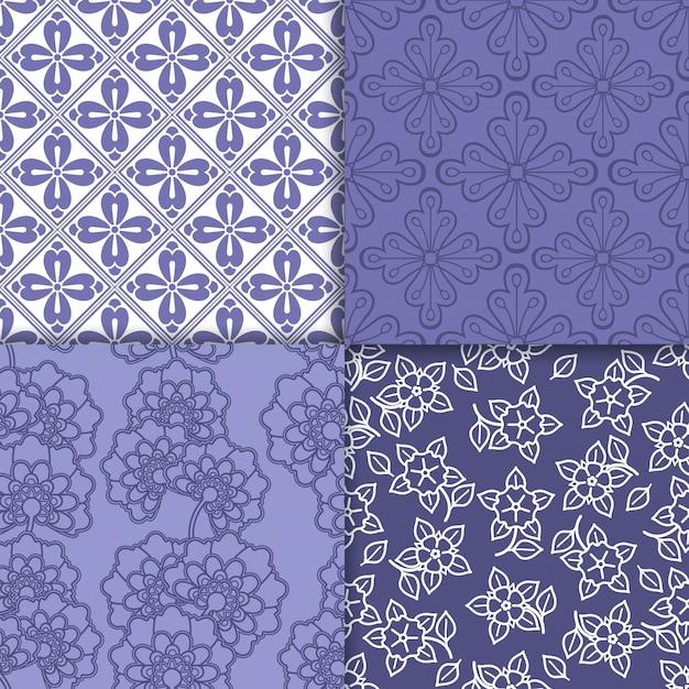 Ensemble de motifs de papier peint à fleurs violet et blanc Vecteur Premium