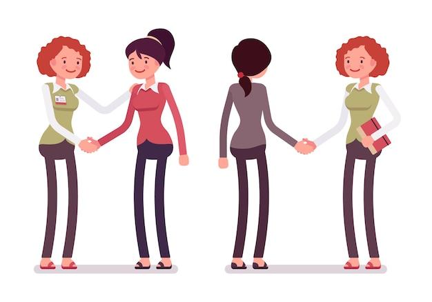 Ensemble de personnages féminins dans une poignée de main de vêtements décontractés Vecteur Premium