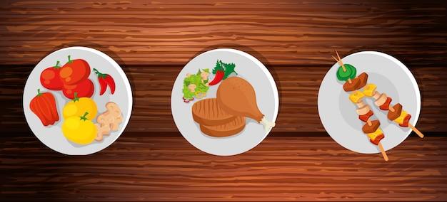 Ensemble de plats délicieux sur fond en bois Vecteur gratuit