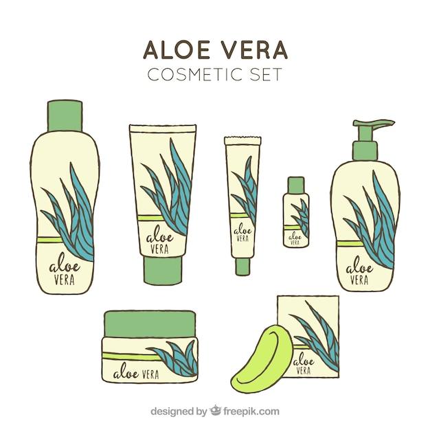 Ensemble de produits à base d'aloe vera à la main Vecteur gratuit