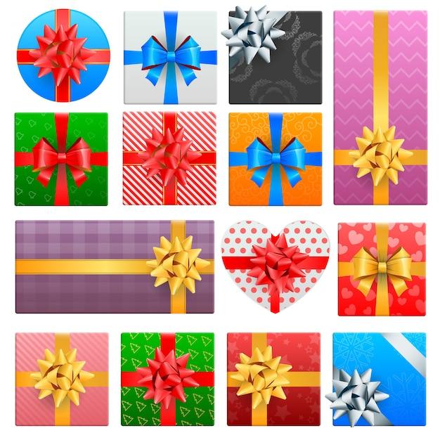 Ensemble Réaliste Enveloppé De Coffrets Cadeaux De Noël Avec Des Arcs De Rubans Colorés Vecteur Premium
