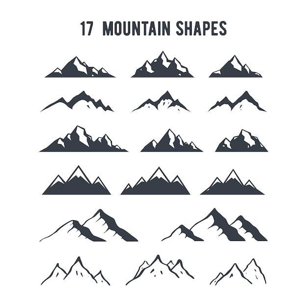 Ensemble de silhouettes de montagne dessinés à la main. Vecteur Premium