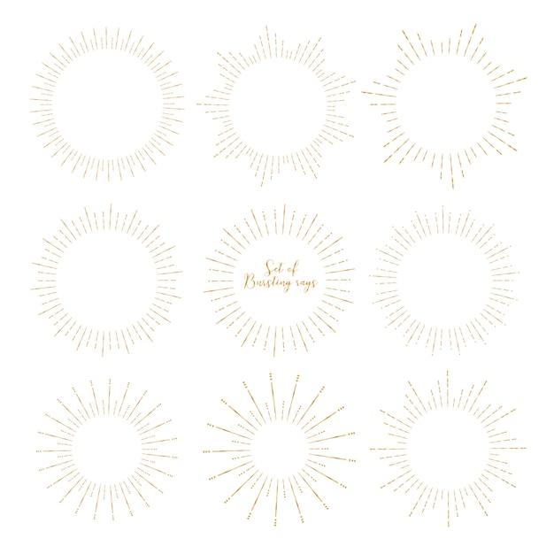 Ensemble de style sunburst doré isolé sur fond blanc. Vecteur Premium