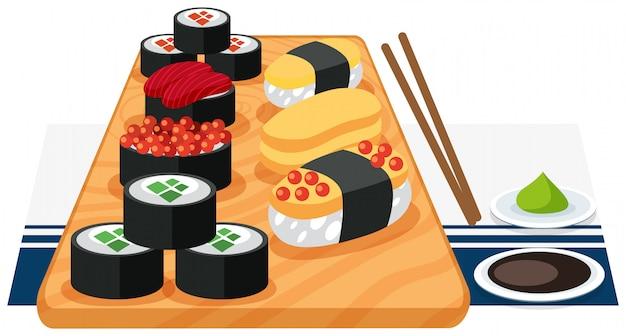 Un ensemble de sushi sur plaque Vecteur gratuit