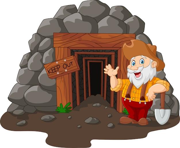 Entrée de la mine de dessin animé avec un mineur d'or Vecteur Premium