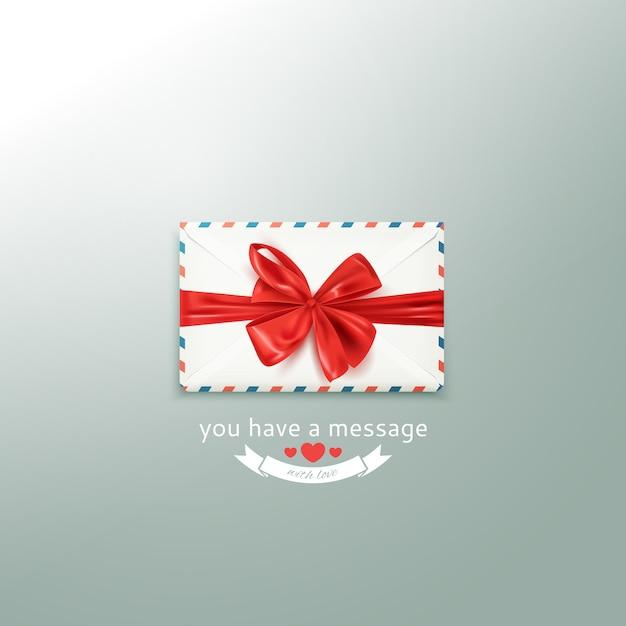 Enveloppe vintage blanche réaliste avec un arc rouge décoratif Vecteur Premium