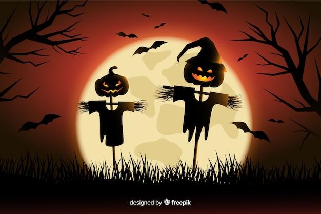 Épouvantail halloween fond au design plat Vecteur gratuit