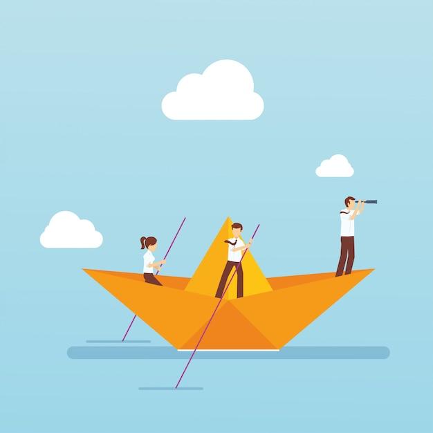Équipe de bussiness avec un bateau en papier dans l'océan Vecteur Premium