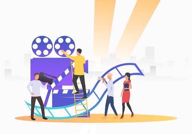 Équipe de tournage filmant Vecteur gratuit