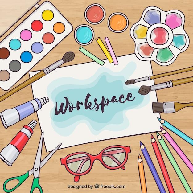 Espace de travail créatif avec des éléments aquarellés Vecteur gratuit