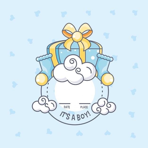 C'est une carte de naissance pour garçon avec boîte-cadeau et chaussettes Vecteur Premium