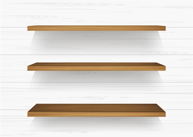 Étagère en bois sur un mur blanc Vecteur Premium