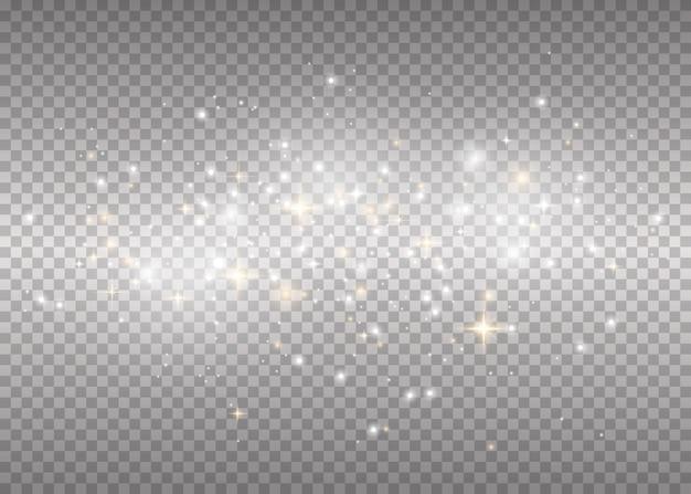 Des étincelles Blanches Et Des étoiles Dorées Brillent D'une Lumière Spéciale. Flash De Noël. Vecteur Premium