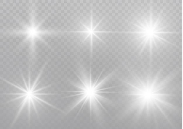 Des étincelles Blanches Scintillent D'un Effet De Lumière Spécial. Scintille Sur Fond Transparent. Particules De Poussière Magique étincelante. Vecteur Premium