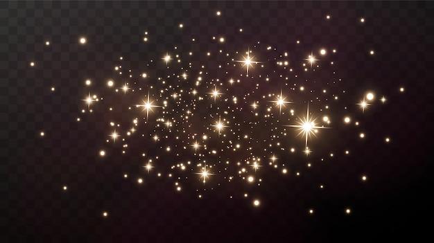 Des étincelles Et Des étoiles Dorées Brillent D'un Effet De Lumière Particulier. Vecteur Premium