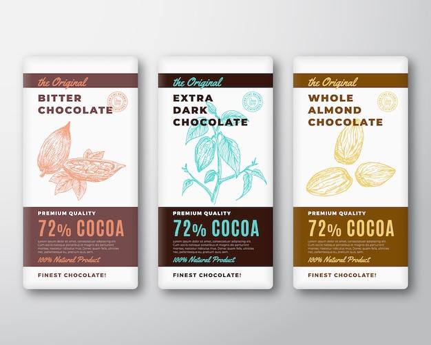 L'étiquette Originale De Conception D'emballage Abstraite De Chocolat Le Plus Fin. Typographie Moderne Et Branche De Cacao Dessinés à La Main Avec Des Feuilles Et Des Noix De Haricots Et D'amandes Croquis De Fond De Silhouette. Vecteur Premium