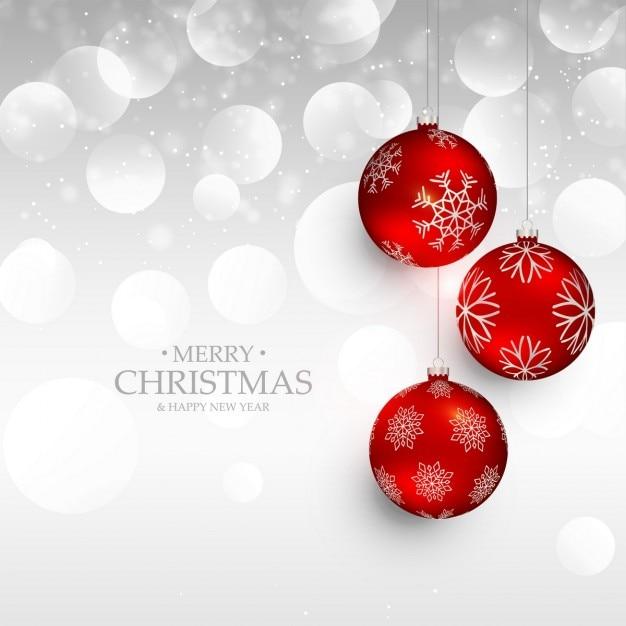 Étonnants Rouges Noël Balles Suspendues Sur L'argent Bokeh Vecteur gratuit