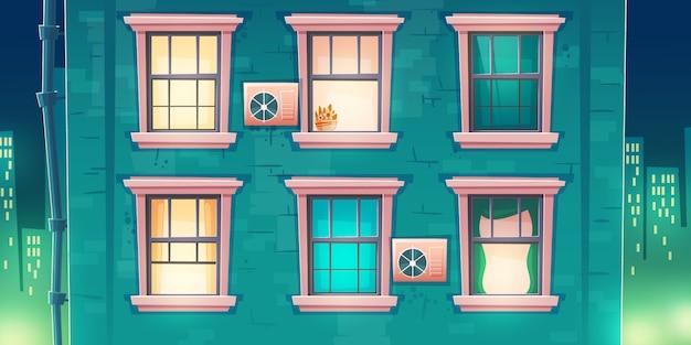 Façade Du Bâtiment Avec Des Fenêtres La Nuit Vecteur gratuit