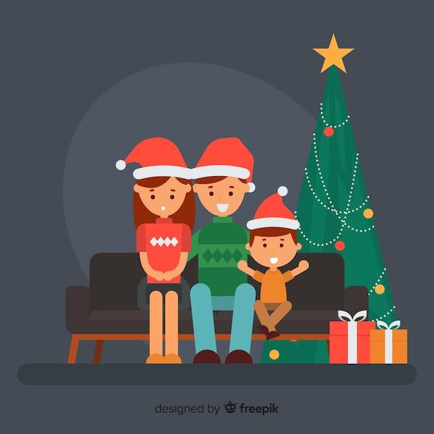 Famille sur le canapé illustration de noël Vecteur gratuit