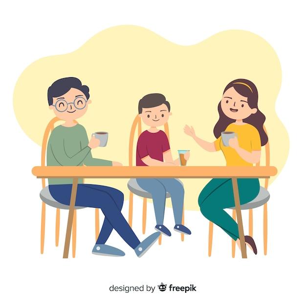 Famille dessiné à la main autour de la table Vecteur gratuit