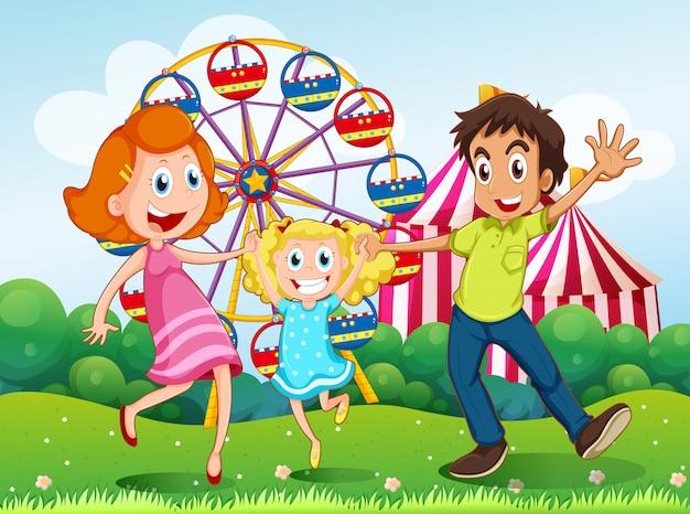 Une famille heureuse au carnaval au sommet d'une colline Vecteur gratuit