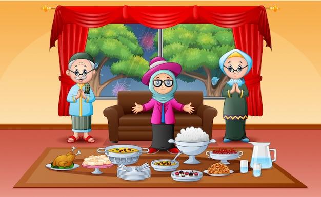 Famille musulmane célébrant l'aïd à l'iftar Vecteur Premium