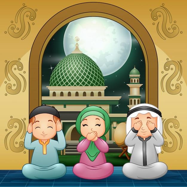 Famille musulmane priant et souhaitant à la mosquée Vecteur Premium