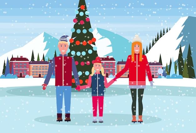 Famille Patinant Dans La Patinoire Avec Un Arbre De Noël Décoré à L'hôtel Dans La Station De Ski Vecteur Premium