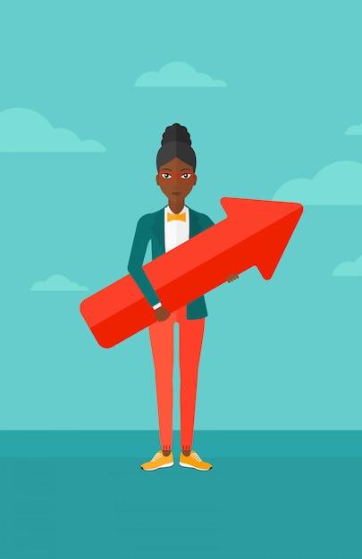 Femme d'affaires réussie avec la flèche vers le haut. Vecteur Premium