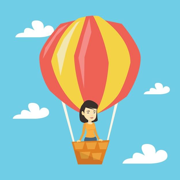 Femme Asiatique Volant En Montgolfière. Vecteur Premium