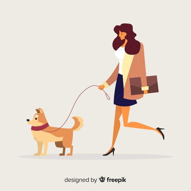 Femme ayant une promenade avec son chien Vecteur gratuit
