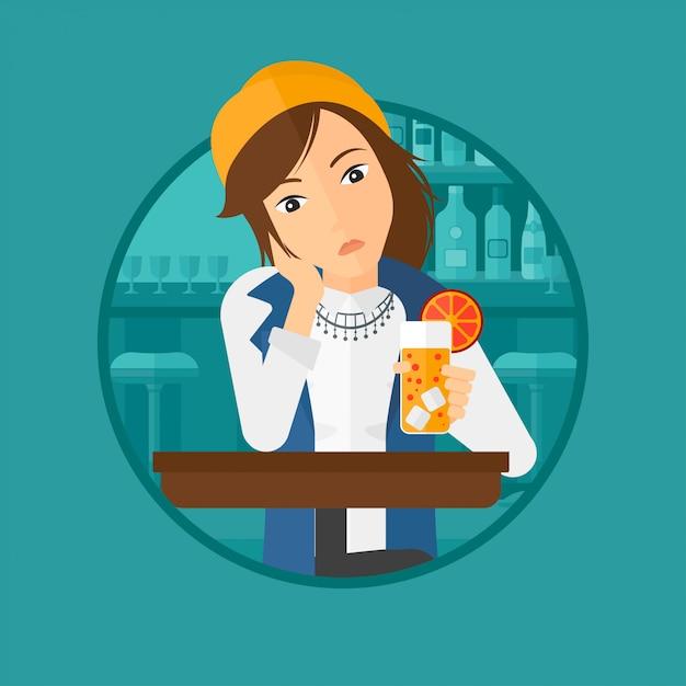 Femme buvant un cocktail orange au bar. Vecteur Premium