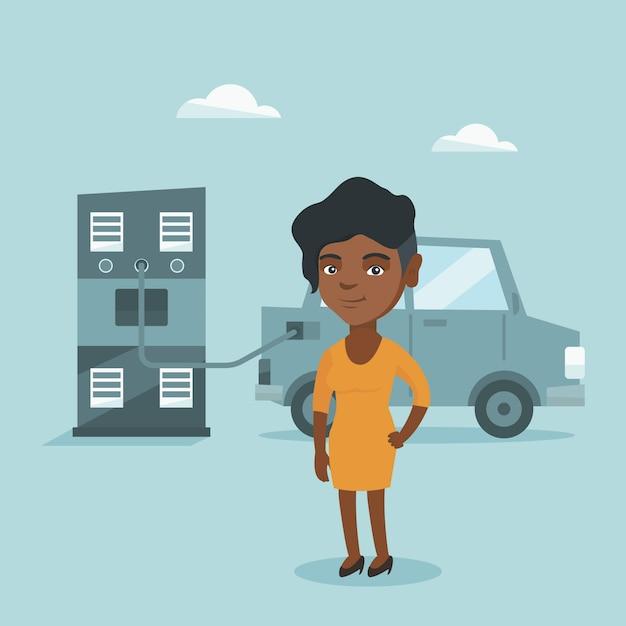 Femme chargeant une voiture électrique à la station de charge. Vecteur Premium