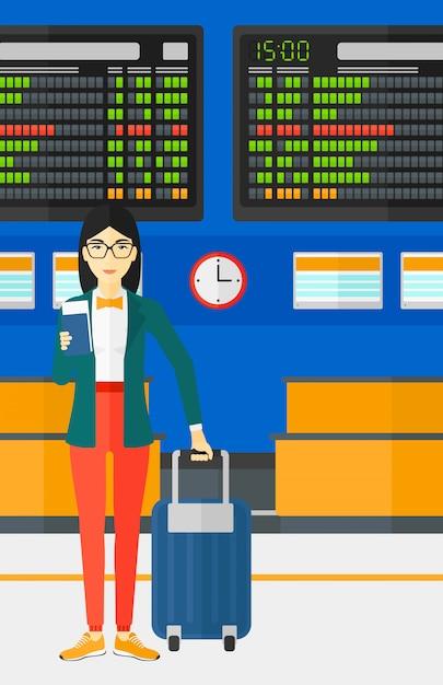 Femme, debout, valise, tenue, billet Vecteur Premium