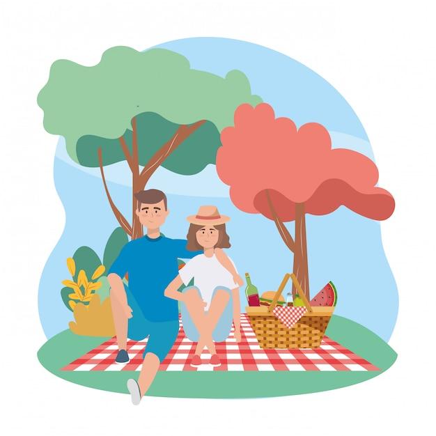 Femme et homme avec bouteille de vin et melon d'eau Vecteur gratuit