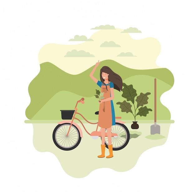 Femme jardinier avec paysage et vélo Vecteur Premium