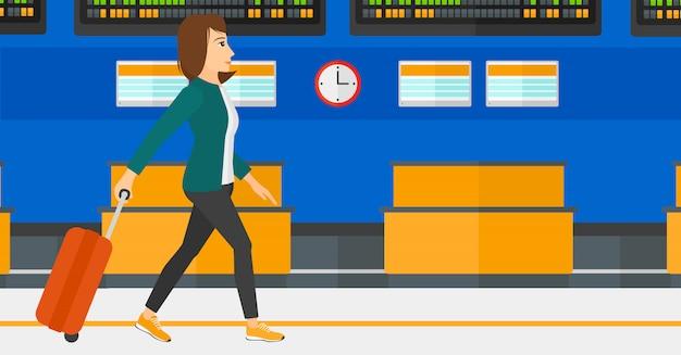 Femme marchant avec valise Vecteur Premium
