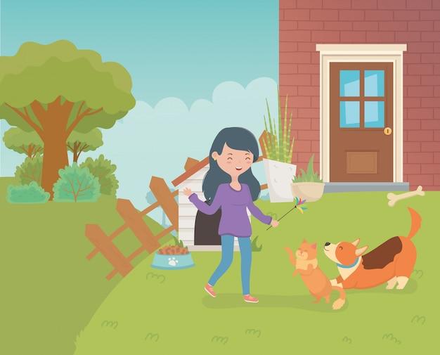 Femme Avec Un Mignon Petit Chat Et Un Chien Dans Le Jardin De La Maison Vecteur Premium