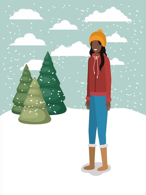 Femme noire en paysage de neige avec des vêtements d'hiver Vecteur Premium