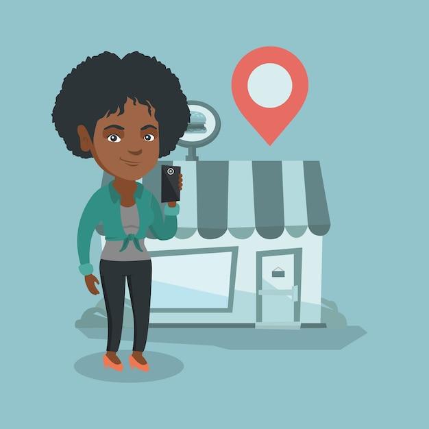 Femme à la recherche d'un restaurant dans son smartphone. Vecteur Premium