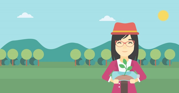 Femme, tenue, plante, croissant, dans, bouteille plastique Vecteur Premium