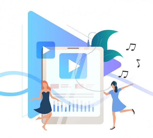 Femmes écoutant de la musique sur un lecteur portable Vecteur gratuit