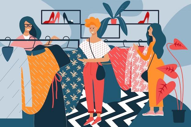 Femmes avec des robes à la main dans le magasin de vêtements. Vecteur Premium