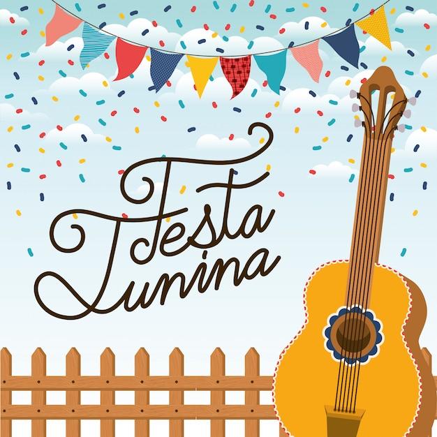 Festa junina avec clôture et guitare Vecteur Premium