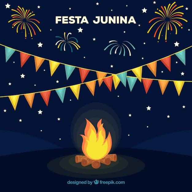 Festa junina fond design avec feu de joie Vecteur gratuit
