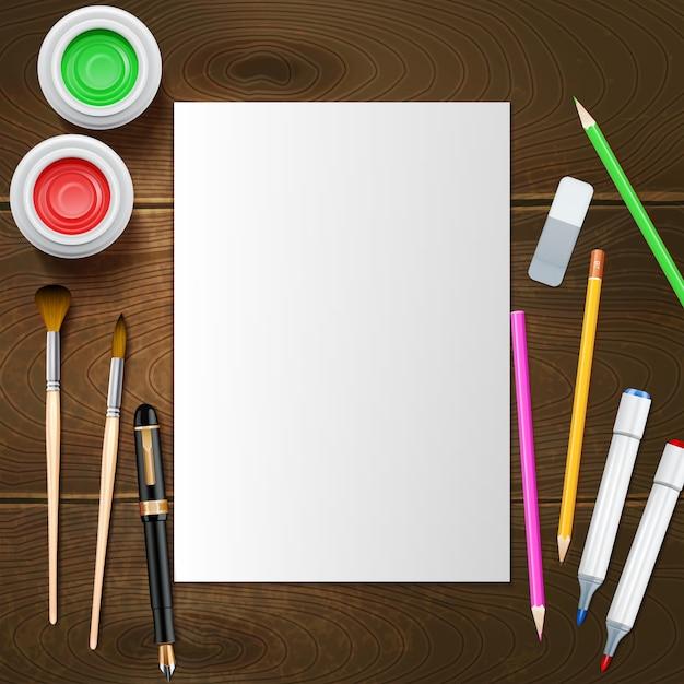 Feuille de papier blanc vierge et instruments de peintre Vecteur gratuit