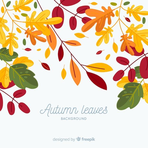Feuilles d'automne fond dans un style plat Vecteur gratuit